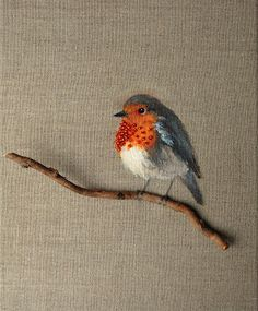 Patrice A.  ****Mixed media bird on a twig.  Real twig, paint, beaded, and stitched.  Lovely!  An idea for cross stitch, too.  --Meggie