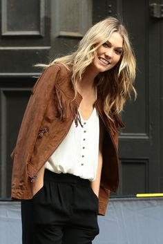 Karlie Kloss rocking the suede trend. Love how she mixed it with classic trousers and a basic top.