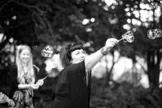 A guests makes big bubbles at a wedding at Alberton House, Mt Albert, Auckland. Black and white.  Love Images creates beguiling fine art bridal images for the most discerning clients. We specialise in natural and relaxed photojournalistic wedding photography, supplying the most exclusive albums and prints from manufacturers such as Cypress Albums, Queensberry and Couture Book. We are a high end studio located in the beautiful city of Auckland, New Zealand.