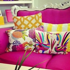 *Love that hot pink and white couch.  That gives me big ideas.