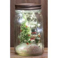 Christmas Crafts with mason jars Mason Jar Lit Snowman Scene Mason Jar Projects, Mason Jar Crafts, Mason Jar Diy, Christmas Mason Jars, Christmas Jars, Christmas Decorations, Mason Jar Snowman, Xmas, Christmas Lanterns