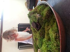 Moss fairy house built in the spirit of celebrating Easter's original pagan holiday Eostre, featuring Ostara the spring like fertility goddess.