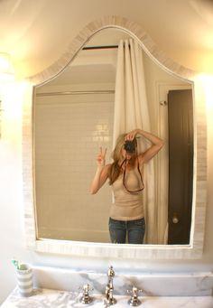 Nest Egg blog. Calcutta gold marble remnant, ballard mirror, shower curtain liner plus drapery rod and three west elm curtain panels