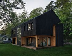 Black Charred Wood Siding Creates A Bold Look For This Lakeside Home New Modern House, Lakeside Cabin, Fireplace Set, Charred Wood, Haus Am See, Glazed Walls, Exterior Cladding, Passive House, Montreal