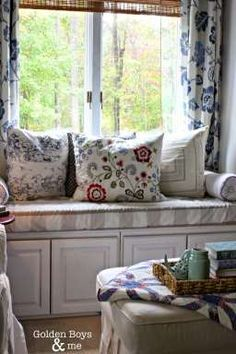 DIY Window seat using upper kitchen cabinets with Ikea pillows and blue stained glass lamp-www.goldenboysandme.com