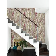 Shades of pink from rose to bubblegum mix with neutral taupes and hints of lavender for a modern approach to color. The wave pattern in this geometric wallpaper creates an abundance of movement across the wall, undulating in and out of splashes of color.