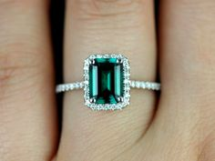 14kt White Gold Rectangle Emerald and Diamond Halo Engagement Ring