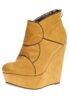 Ooh! Wedge boots - yellow