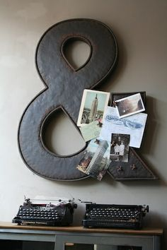 """Magnetic ampersand in home office with vintage typewriters displayed. i use my 1945 Royal typewriter for outgoing mail. I tell visiting children that the typewriter in my office is """"what we used before computers and the internet"""". They touch the keys like it came from a museum!"""