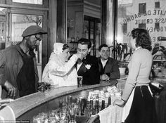 Striking: This photograph, taken in the 1950s, shows customers, including a newly married couple, enjoying a drink in a brasserie