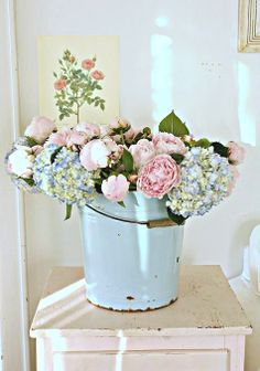 I don't really like those flowers in that buckets...Maybe sunflowers...something orange or yellow. Still adorable!