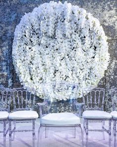 This white #floralwall makes for one seriously dreamy backdrop. See more on WedLuxe.com. (: @jerrymeyestudio, planning, floral & decor: @bircheventdesign, venue: Old Westbury Hebrew Congregation, furniture: @luxeeventrentals)