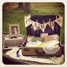 DIY vintage suitcase card box. Love the purple satin in the back!