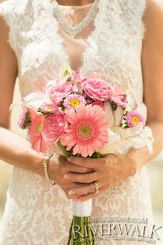This beautiful brides wedding included a Seasonal Bridal Bouquet in Shades of Pink. All Inclusive Wedding Packages! www.MarriageIsland.com  (210) 667-6503. San Antonio Riverwalk Weddings.
