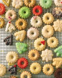Rich, buttery, and made with lots of vanilla, these cookies are simple to make. Use a cookie press -- a hollow tube fitted with a decorative nozzle at one end and a plunger at the other -- to press the cookies directly onto the baking sheet.