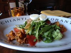 Worth their weight in gold - Chanterelle mushrooms, quail eggs, and heirloom tomatoes on Chianti's Summer Salad #mushrooms #chianti