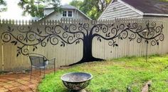 beautifully decorated fence with a painted tree