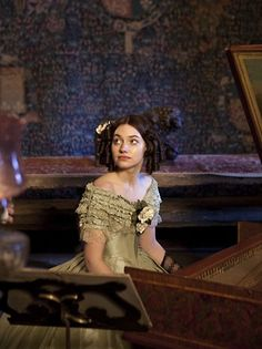 """Imogen Poots as Blanche Ingram playing piano in Jane Eyre """"There are Mrs. Eshton and her three daughters — very elegant young ladies indeed; and there are the Honourable Blanche and Mary. Jane Eyre Movie, Jane Austen, Period Costumes, Movie Costumes, Theatre Costumes, Keanu Matrix, Jane Eyre 2011, Imogen Poots, Charlotte Bronte"""