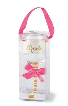 Glitter and Gold. This beautiful 'Bride' wine glass features fully glittered gold and white lettering with glitter striped stem, base and white topstitched bow in pink. Comes in acetate box with ribbo