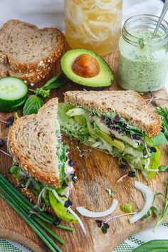 Green Goddess Sandwich Recipe : A fresh sandwich with juicy tomatoes,cool avocado, tangy apish and onions, greens, creamy mozzarella and a green goddess mayonnaise that is packed with flavour! Veggie Recipes, Lunch Recipes, Vegetarian Recipes, Dinner Recipes, Cooking Recipes, Healthy Recipes, Cooking Food, Free Recipes, Healthy Desayunos