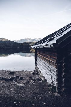 Love the mood of this wooden cabin at a lake.