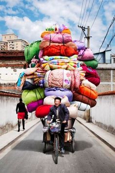 Overloaded Bike in Shanghai, China.    I try to take a pic when I see this!!!  From Constance:: am in Shanghai right now, not able to use FB or twitter ( from here) but tickled to see Pinterest Open For Business :) I wonder if this will post to FB?