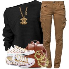 Gold necklace, brown cargos, UGG sneakers, grey oversized sweater.