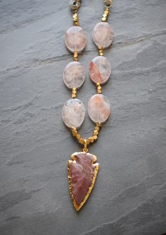 Rose Quartz gemstones in bohemian luxury jewelry. Arrowhead necklace. Gemstone Feature: Rose Quartz — The Two Hand Exchange