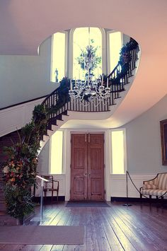 """Each year, the Garden Club of Charleston uses the Joseph Manigault House as a backdrop for their creative arrangements, using only live plant materials that would have been available in the Lowcountry during the first quarter of the 19th century. This year's theme is """"Charleston's Antebellum Charms""""."""