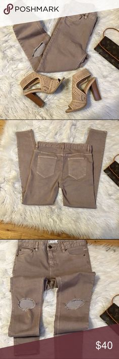 Free people khaki distressed jeans Free people khaki distressed jeggings  skinny jeans.  In excellent condition. Material cotton and rayon. Jeans has plenty of stretch to flatter your figure. Size 28 waist Free People Jeans Skinny