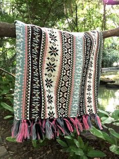 Find comfort and coziness under this bohemian throw blanket and add a dose of color and hippie charm to your humble abode. The tribal fabric is heavy