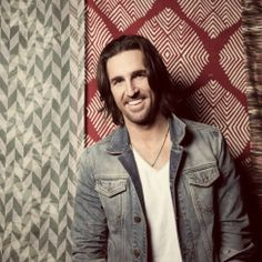Watch Jake Owens reaction after seeing a man HIT a woman during his show.