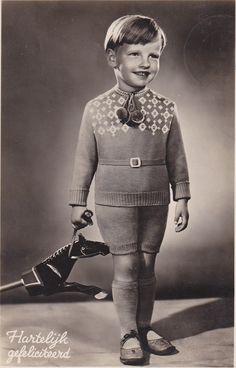 Dutch child with toy, 1940s postcard-Black & white real photo postcard (RPPC), paper ephemera.
