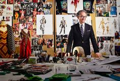 William Ivey Long, photographed in his New York studio, in front of his mood boards for the <em>Rocky Horror Picture Show</em> TV movie. Photograph by Jonathan Becker.