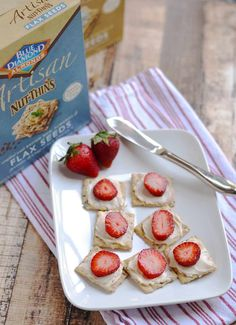 I've got an easy snack idea for y'all today – strawberries and light creamy swiss cheese on Blue Diamond Nuts Thins crackers. YUM.