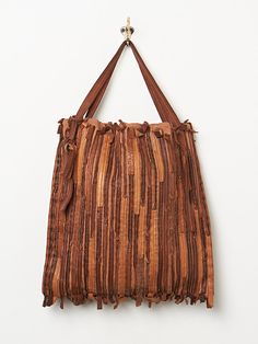 Free People Cosmio Pieced Tote, not beaded but lovely. (i cannot resist pinning it)