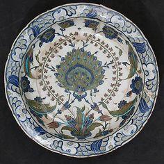 Dish with Floral Design Dish Date: ca. 1545–60 Turkey, Iznik Medium: Stonepaste; polychrome painted under transparent glaze H. 2 7/8 in. (7.3 cm) Diam. 13 7/8 in. (35.2 cm)