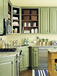 I kinda want green kitchen cabinets. Less Is More ~ Removing the doors from some of the upper cabinets reveals the space inside, making the kitchen look larger. Paint the interior a rich accent color to spice up the kitchen even more. Green Kitchen Cabinets, Kitchen Cabinet Colors, Painting Kitchen Cabinets, Kitchen Paint, Kitchen Redo, New Kitchen, Upper Cabinets, Kitchen Ideas, Colored Cabinets