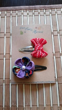 Purple flower and hair bow snap hair clips. They are made of Traditional Japanese kimono fabric called Chirimen(crape fabric). They are perfect for gifts! Hair Barrettes, Hair Clips, Traditional Japanese Kimono, Flower Hair Bows, Kimono Fabric, Japanese Fabric, Baby Accessories, Purple Flowers, Birthday Gifts
