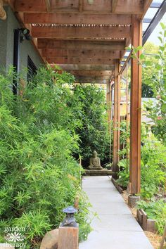 Walkway garden by a studio to a small meditation space. Come tour some quirky and diverse Secret Gardens like this one.