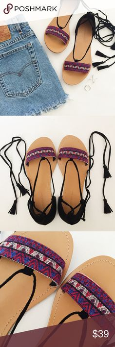 Tribal Lace Up Sandals Tribal Lace Up Sandals in black, red and blue featuring boho tribal print and tassel accents.  Casual cute!  Wear with cut offs or a maxi dress!  NWT, never worn!  Original box included. Wild Diva Shoes