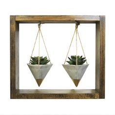 Add a modern rustic touch to your home or office with this unique wooden shadow box wall planter with double hanging concrete geometric planters handmade by Timberline Studio. Perfect for small indoor plants such as air plants, succulents, or cacti (or a faux one, if you prefer). Can be hung on the wall or simply sat on a desk or windowsill.