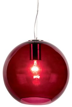 A perfect globe of red glass with a small aperture at the base for easy light bulb changing, helps add a warm glow to the light given off from this contemporary pendant light.