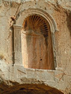 """One of several niches carved into rock to house statues of Pan at Banias - An archaeological site by the ancient city of Caesarea Philippi, located at the foot of Mount Hermon in the Golan Heights. The city was located within the region known as the """"Panion"""" (the region of the Greek god Pan), and is named after the deity associated with the grotto and shrines close to the spring called """"Paneas"""". - Photo: Bruce Bryant"""