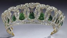 """The Grand Duchess Vladimir Tiara, as modified by Queen Mary so that the pearls could be interchanged with emeralds. It became a favorite tiara for Queen Mary, particularly when she was wearing the matching emerald suite, the Cambridge and Delhi Durbar Parure. Thus the incorporation of the exceptional quality Cambridge emeralds into the """"Vladimir Tiara"""" made it a complementary piece to the Cambridge and Delhi Durbar Parure."""