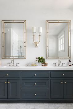 Master bathroom with dark navy vanity cabinets, gold detail, natural styling, marble flooring | Studio McGee Blog