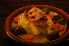cod, mash potatoes, sauted vegetables and shrimps