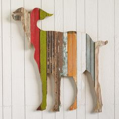 "BILLY THE GOAT -- Art that stands apart from the herd - our colorful goat, handcrafted from reclaimed wood boards, each retaining its original paint, grooves or routing. Hook for hanging. 31""W x 1-1/2""D x 32""H."
