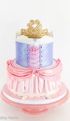 9 Absolutely Gorgeous Princess Cakes - Planning a princess party? Since it's one of the most popular birthday party themes, we wanted to share a few of our favorite princess cake ideas. Make her birthday wish come true with one of these fairy tale cakes like this pretty princess dress cake by Bliss Pastry.