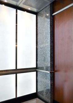 The design required attention to material, scale and form. Taking inspiration from the architecture of both exterior and interior details allowed the designers at Premier Elevator to harmonize the public spaces. This address had two glass panorama cabs and two interior elevators. By capturing key features and bringing them directly into the elevator reduced the amount of decorative materials in the building subsequently celebrating the original architectural intent.